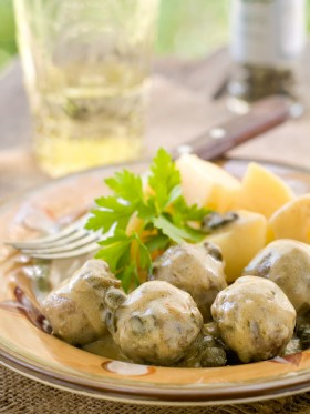 Meatballs with sauce and boiled potatoes